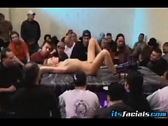 Teenager Holly Wollin is fucked by a crazy fucking machine. The room is filled by Hundreds of men waiting to cum all over her pretty face. Insane!..