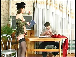 Mature mom plays with her boy in teacher