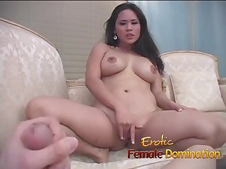 Asian doctor has fun kicking and jerking a patient's cock