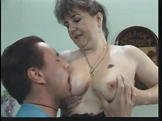 Busty mom blows