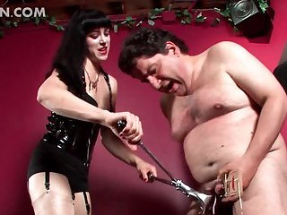Slutty mistress using BDSM torture on her man