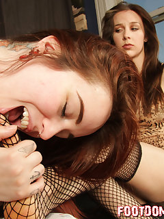 <!–-IMAGE_COUNT-–> of Genetica gets her fishnet stockings worshipp by slave girl