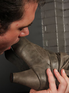 <!–-IMAGE_COUNT-–> of Mistress O boot worship session in the dungeon