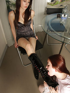 <!–-IMAGE_COUNT-–> of Genetica gets a nice boot shine from slave girl before going outdoors