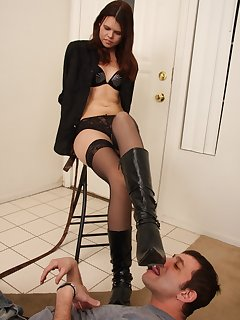 <!–-IMAGE_COUNT-–> of Chastity makes her slave get under her boots and lick them clean