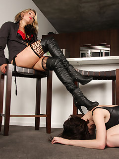 <!–-IMAGE_COUNT-–> of Dominating slave girl under her boots