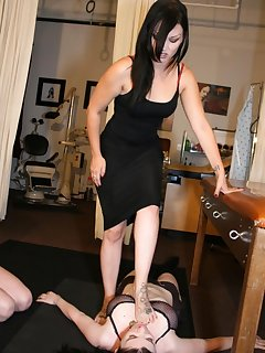 <!–-IMAGE_COUNT-–> of Mistress is trampling slavegirl while another one licking her feet