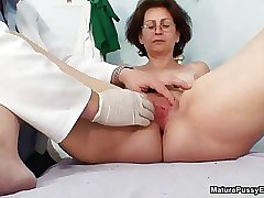 Grandma gets her freshly shaved pussy fingered