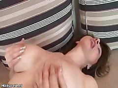 Busty mature slut goes crazy rubbing her twat