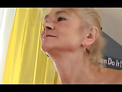 Old mature lady loves sucking on a black cock